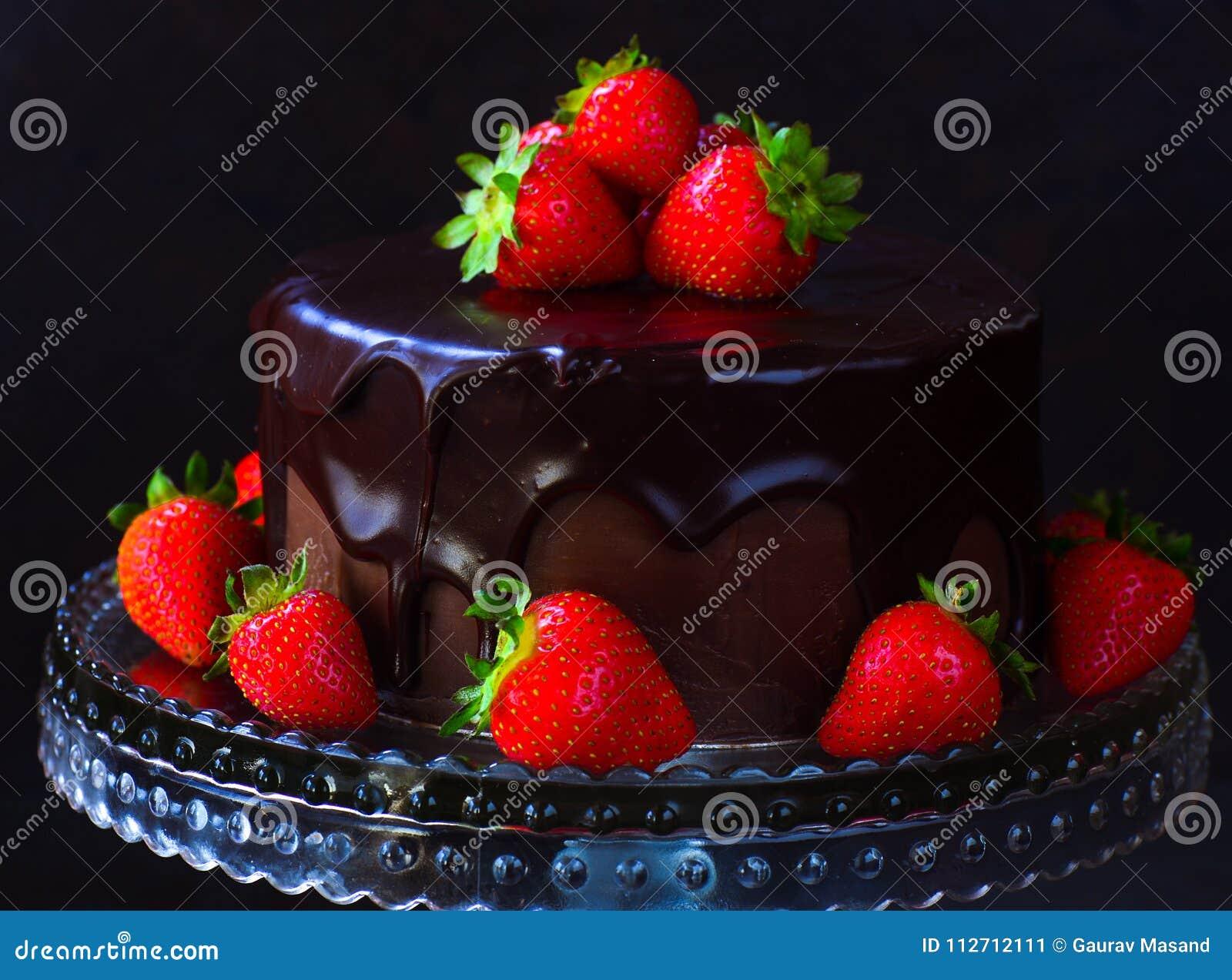 Dark chocolate ganache cake with strawberries