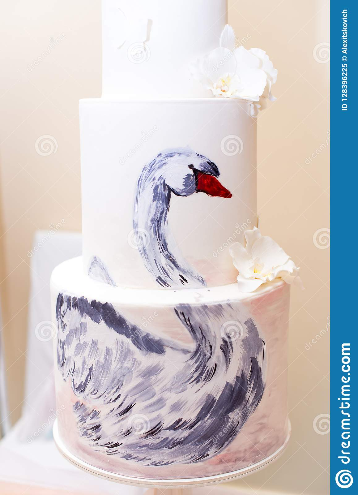 Cake with a picture Swan, with white flowers