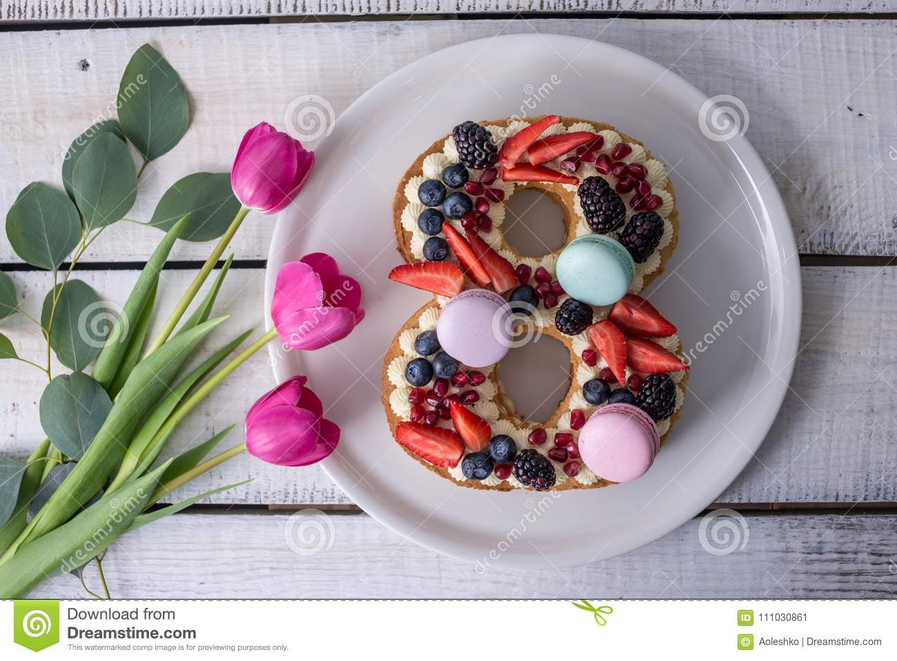 Cake In Shape Of Number 8 Decorated With Berries And Flowers Tulips
