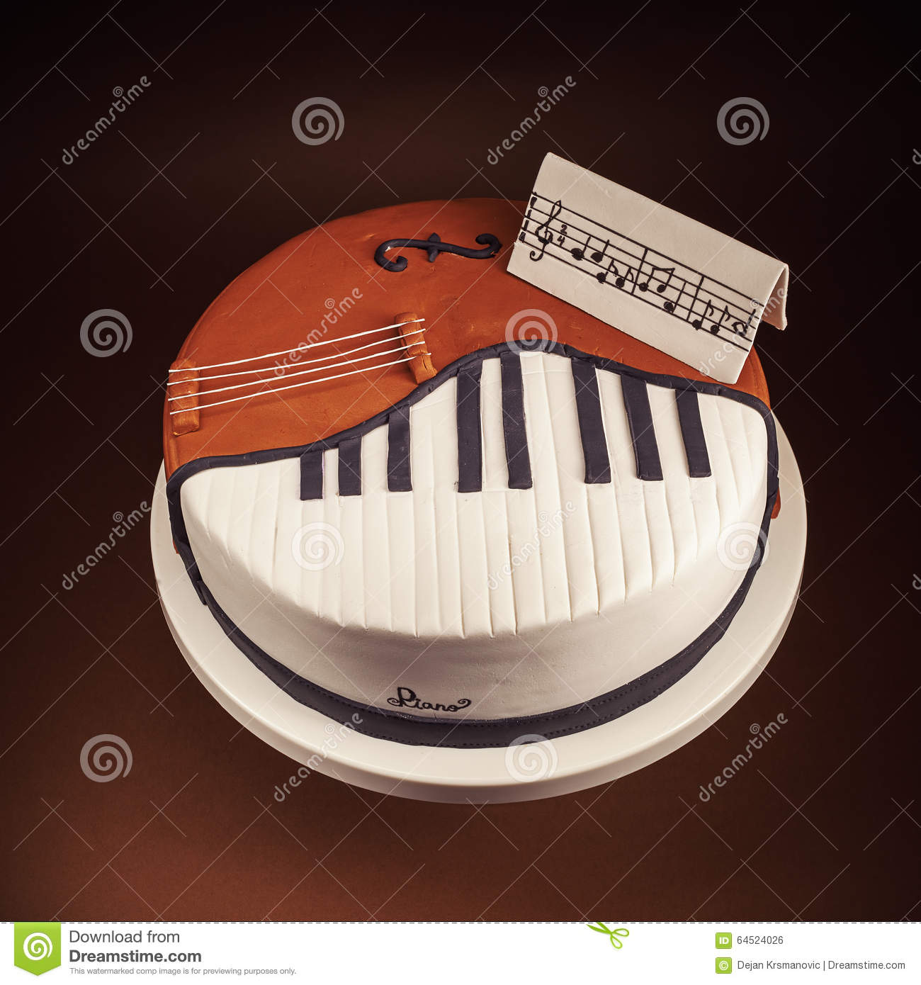 Birthday Cake Decorated With Fondant Rounded Symbolically Presenting Piano And Cello Instruments