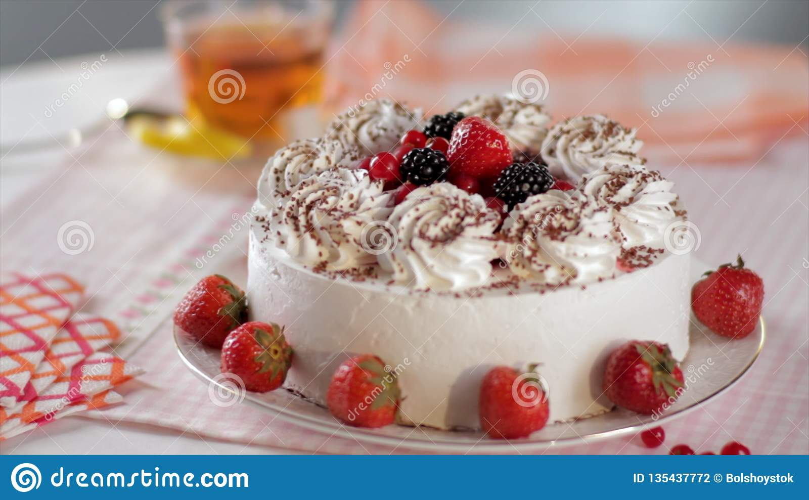 Cake With Whipped Cream And Strawberries On A Stand Close