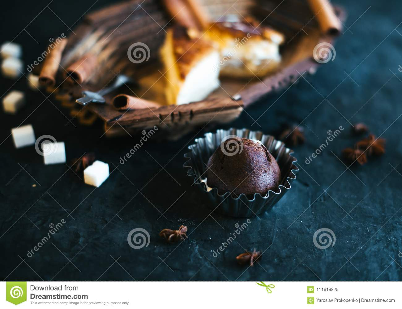 Cake on a wooden tray on a black matte background