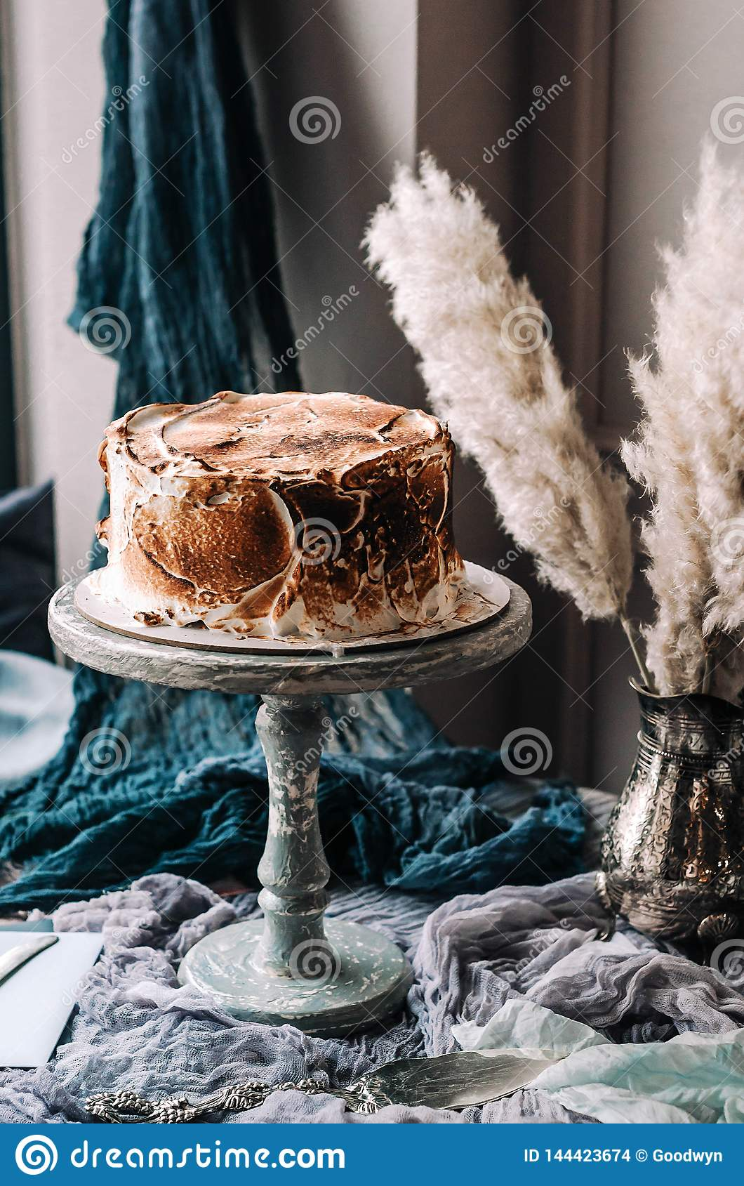 Cream cake on a wooden vintage stand.