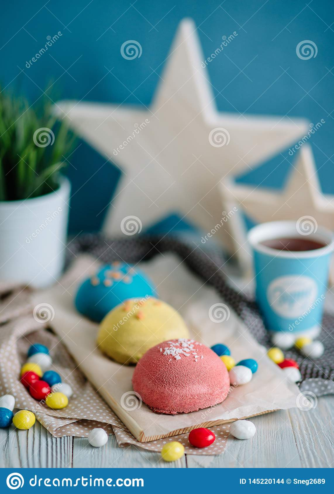 Cakes of different colors in still life
