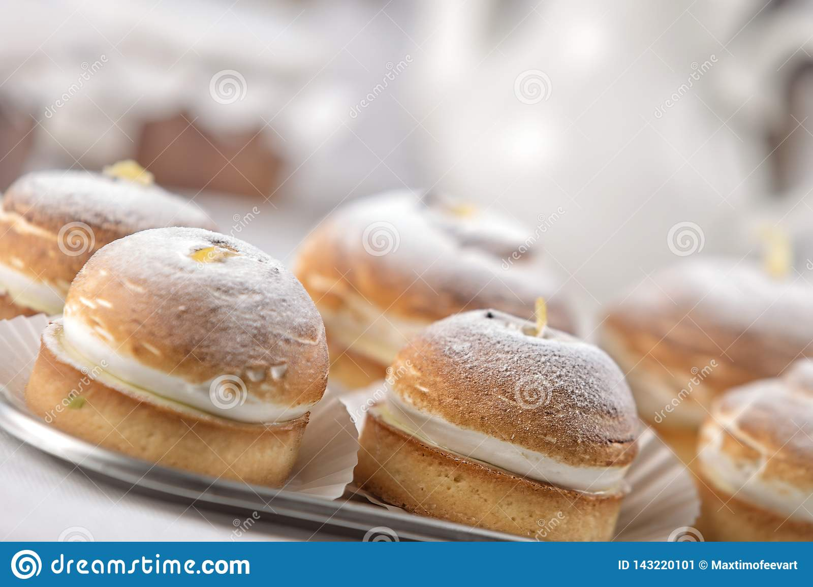 cakes on a tray, restaurant setting