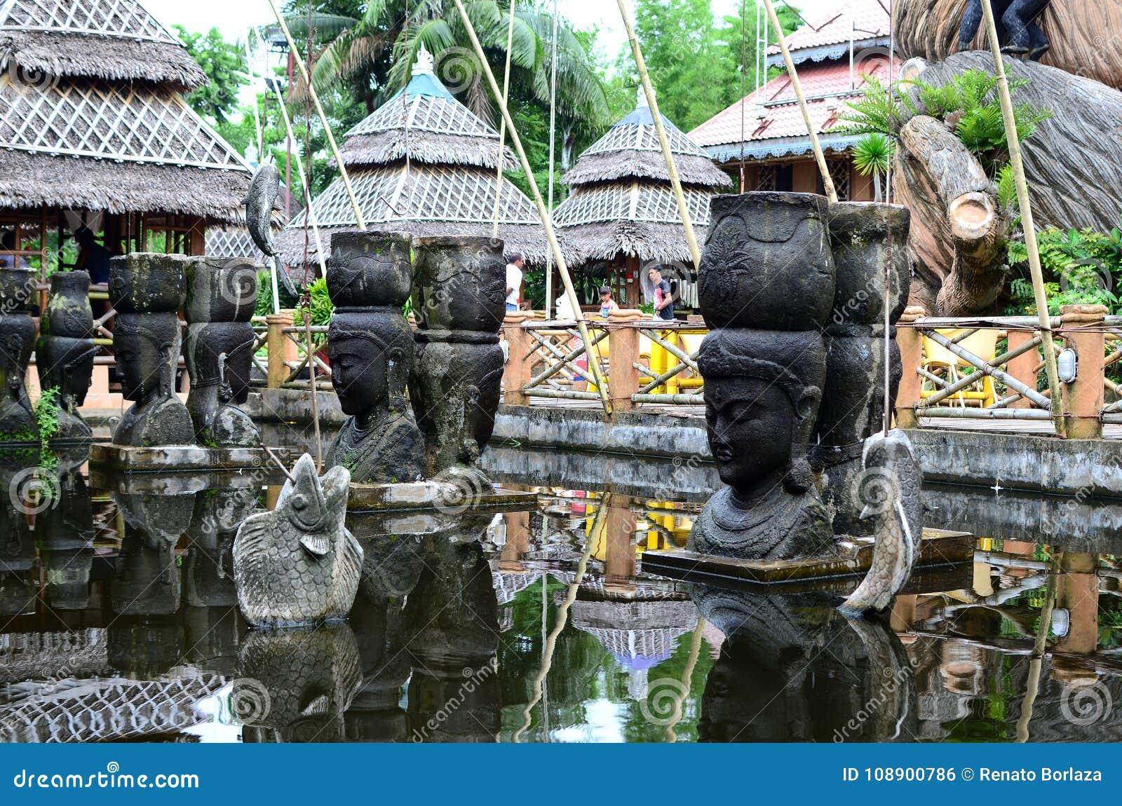 Giant stone buddha decorates an Asian aquatic jungle theme park