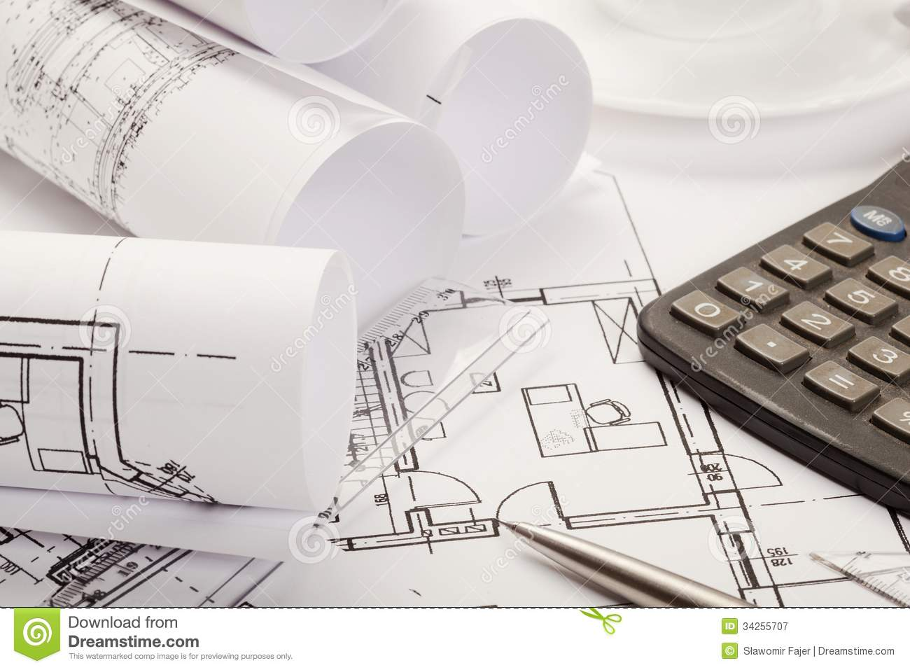 Calculator On Architecture Blueprints Royalty Free Stock
