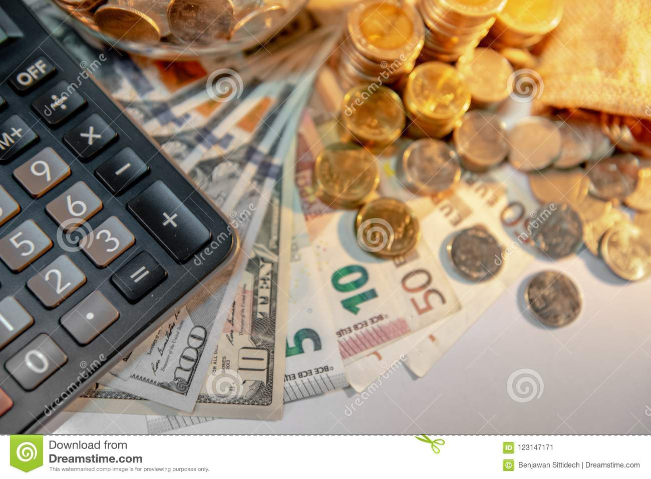 calculator and international currency on the table stock image