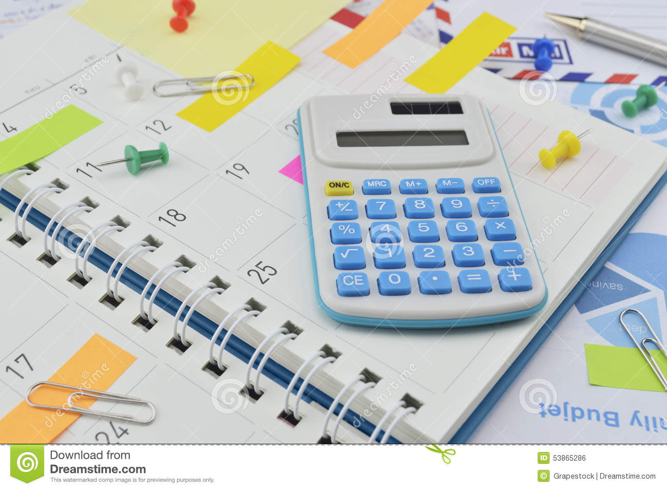 Calculator With Colorful Post It Notes On Business Diary