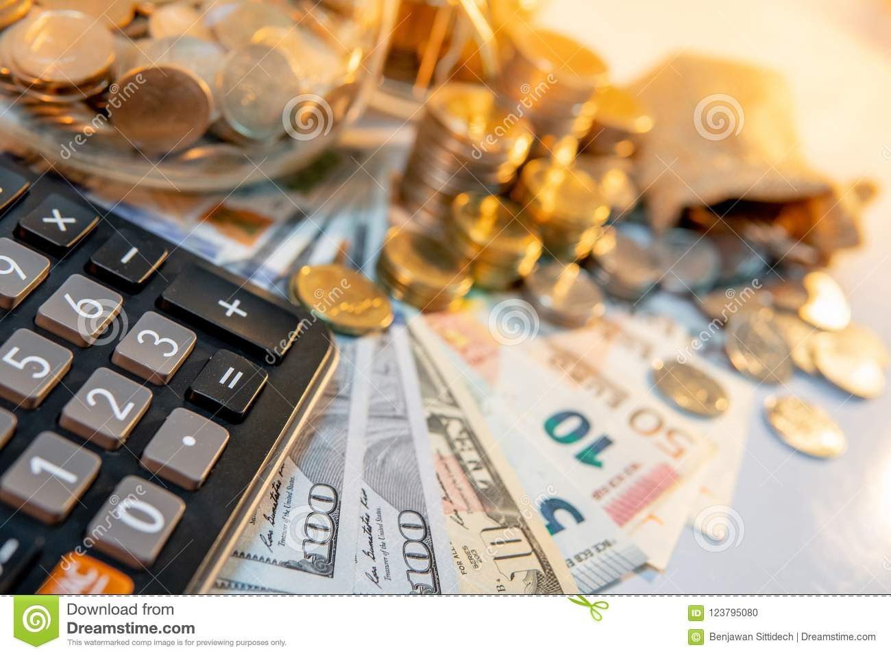 calculator with international currency on the table stock photo