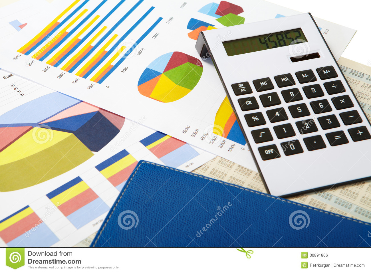 Calculator and diagrams on a business background stock photo image royalty free stock photo ccuart Gallery