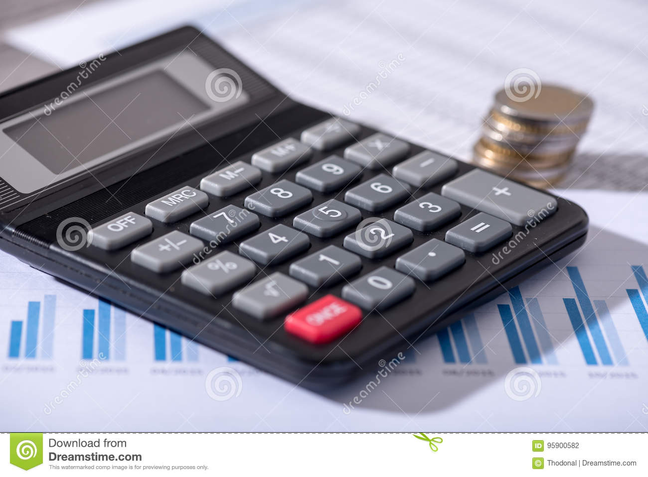 Calculator on financial documents, accounting concept