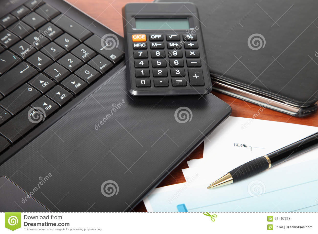 calculator laptop tablet and financial documents stock photo