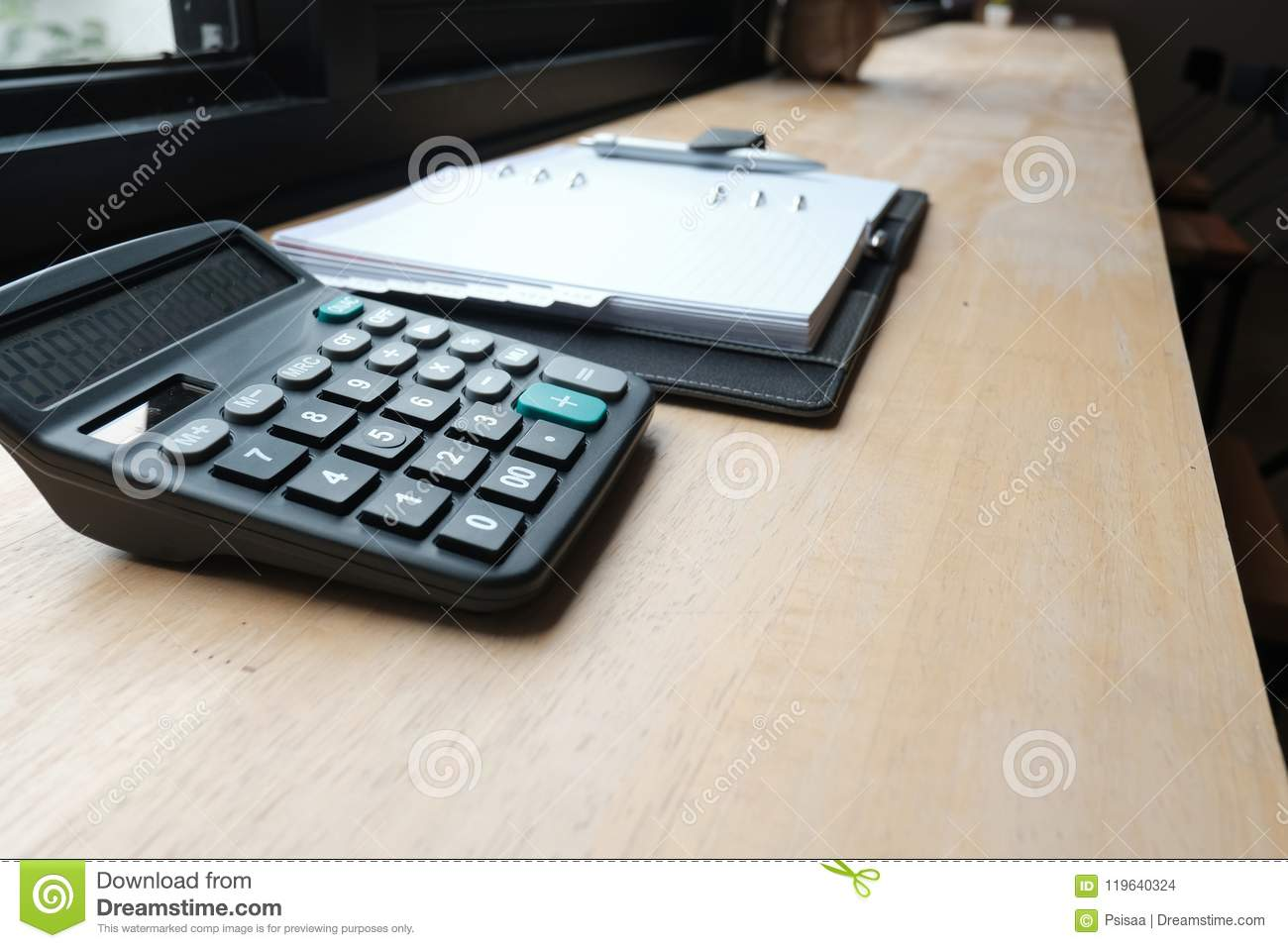 calculator notebook on accountant desk bookeeper financial i