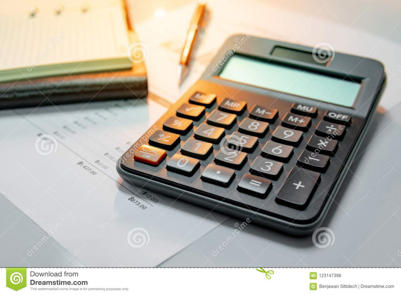 Calculator, notebook, pen and summary report paper