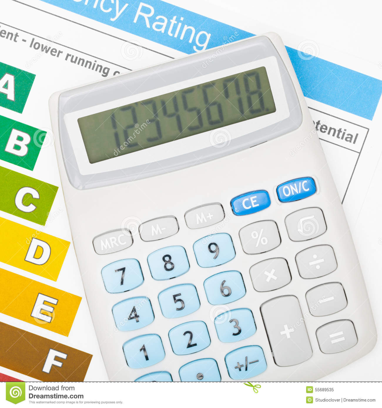 Calculator over energy efficiency chart - close up