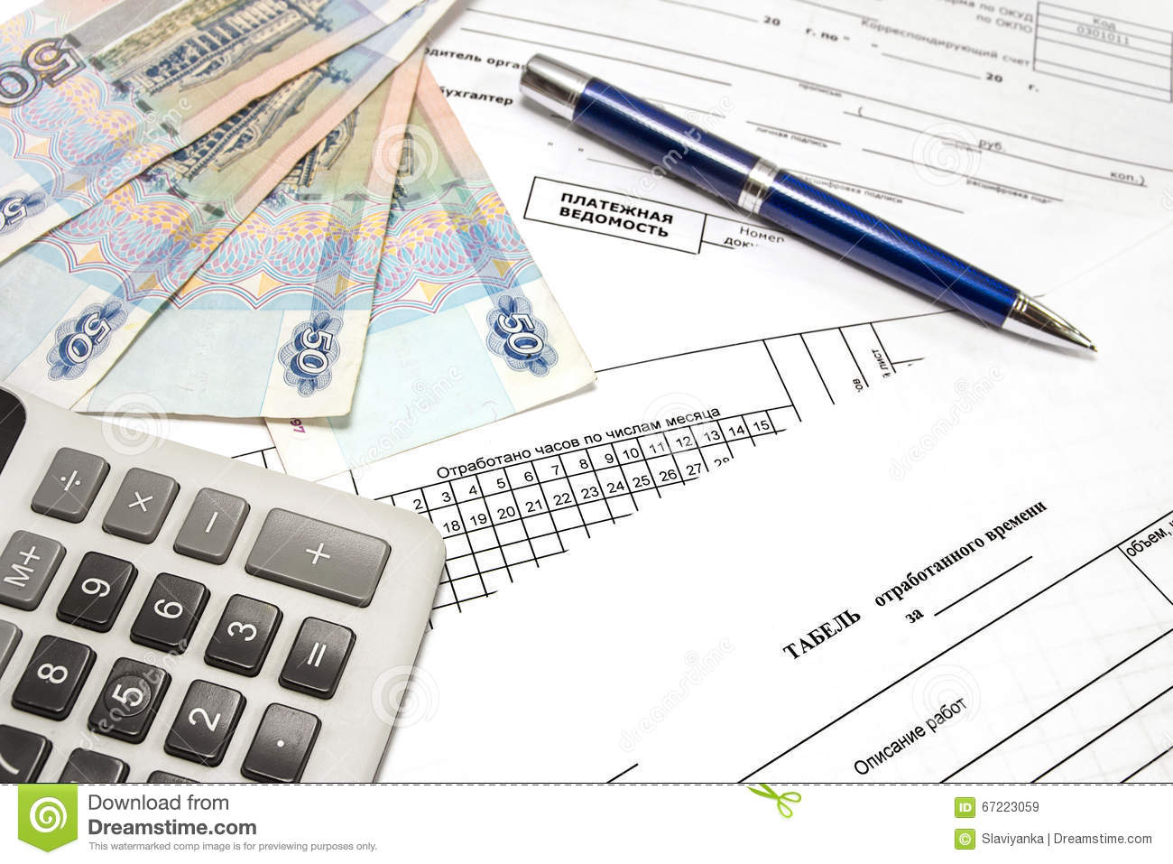 calculator pen money and primary documents for payroll stock image