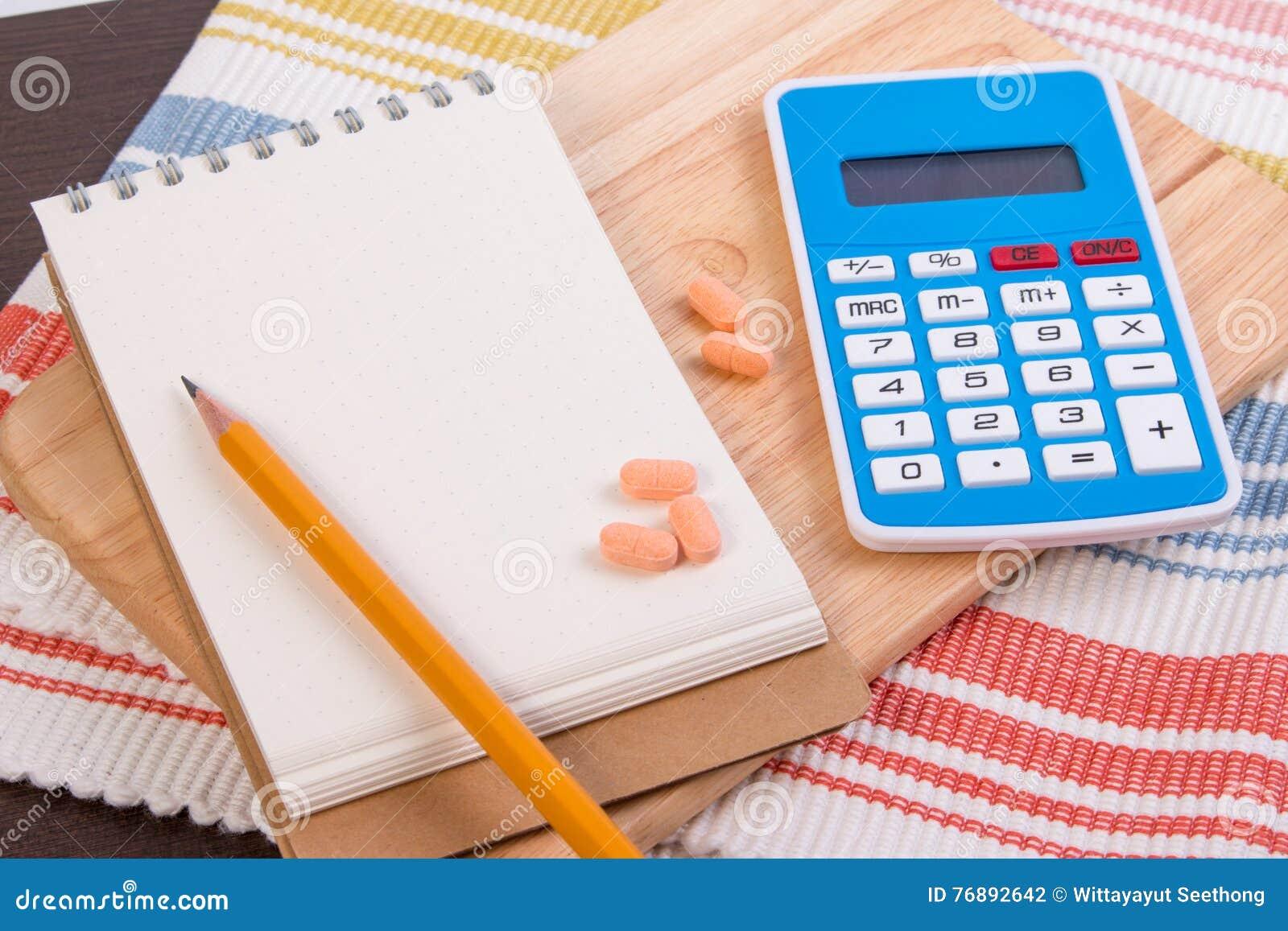 Calcule calorias para perder o peso Caloria que conta em um papel
