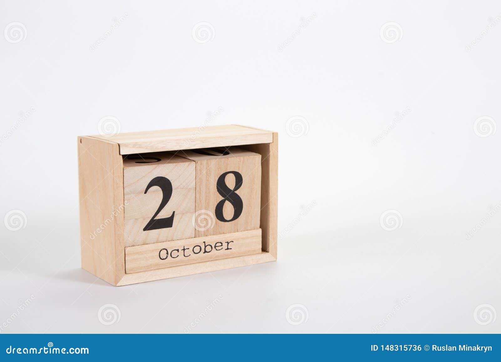 Calendário o 28 de outubro de madeira em um fundo branco