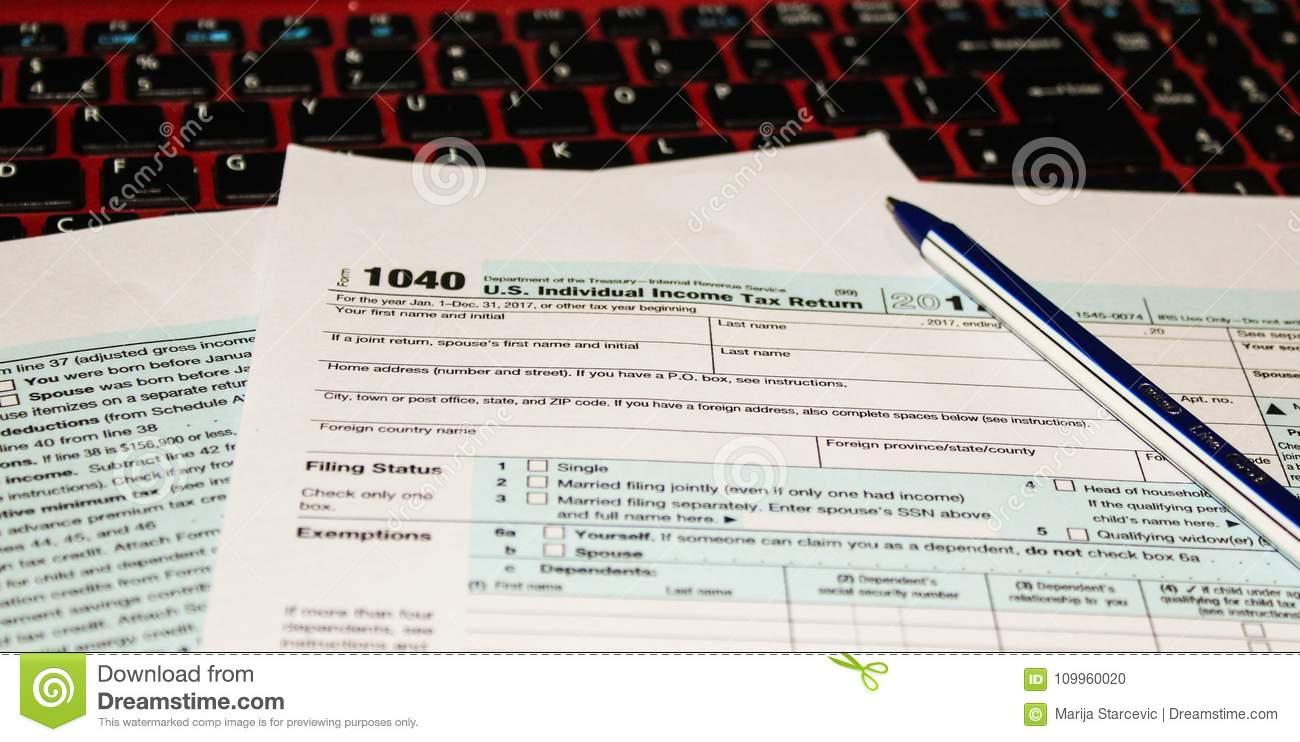 Calendar And Form 1040 Income Tax Form For 2017 Showing Tax