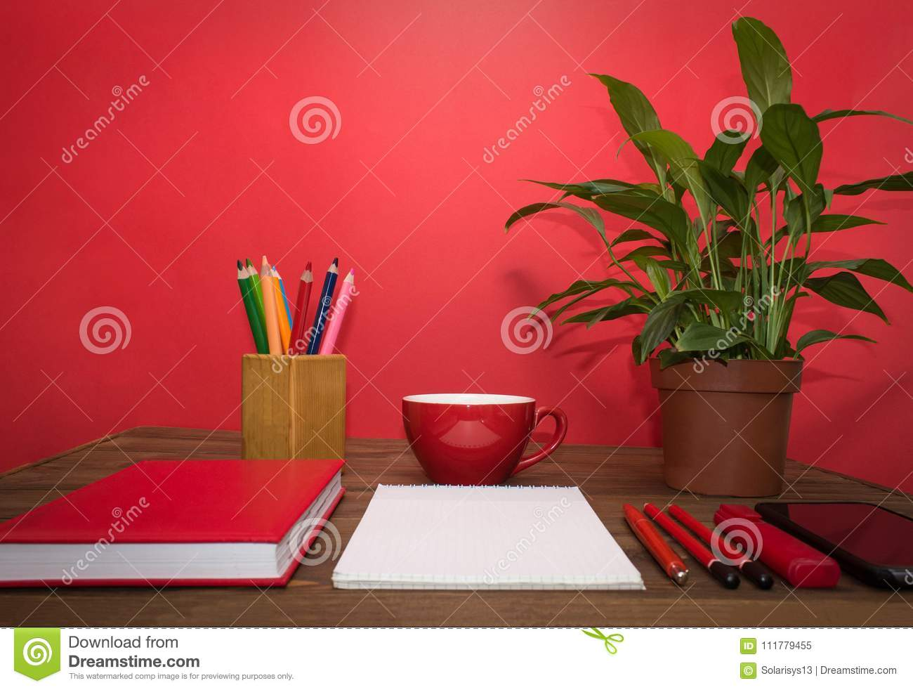 Note book and pencil with cup coffee on wooden table