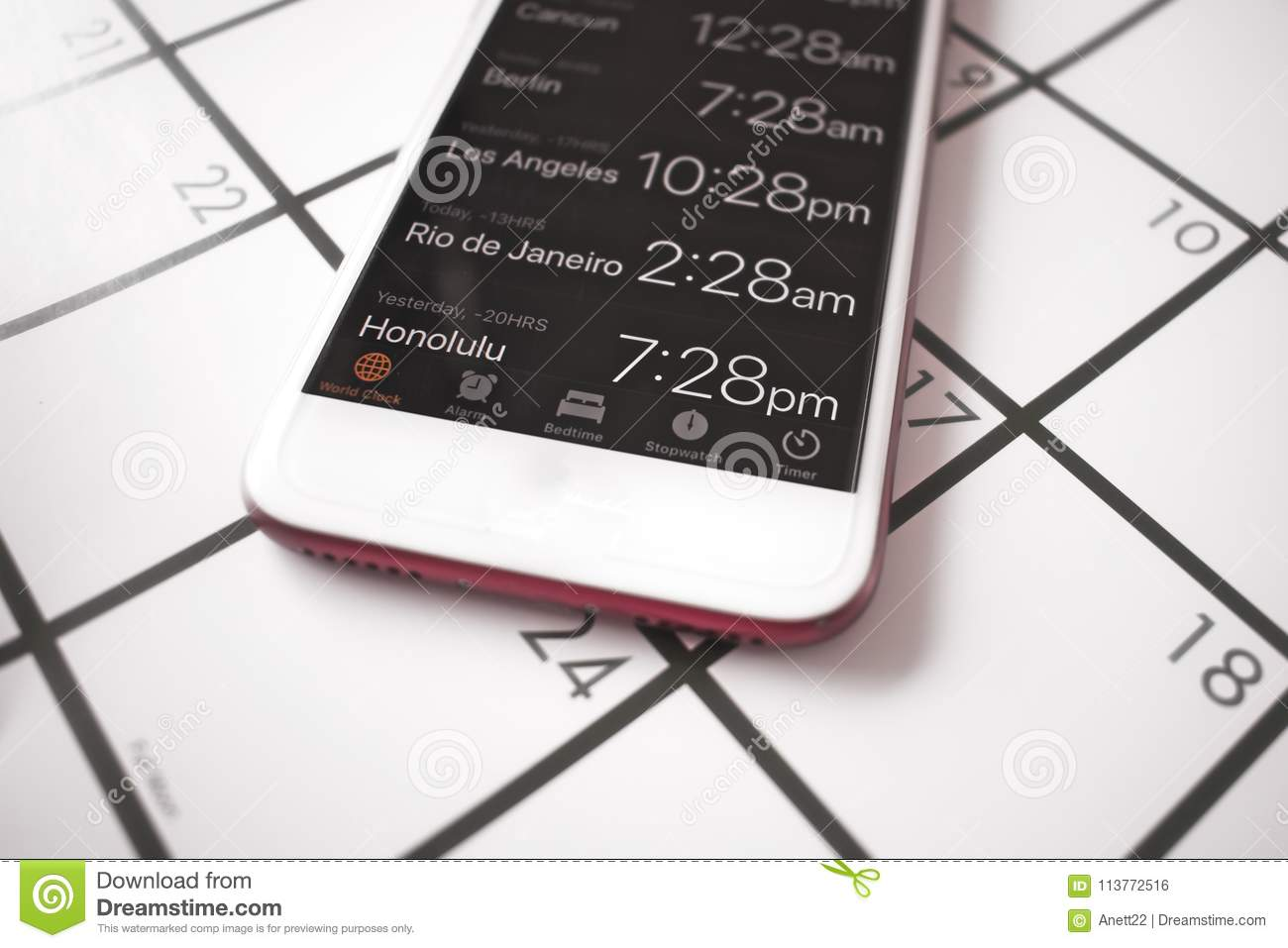 A Calendar And A World Time App On A Mobile Phone Are Used