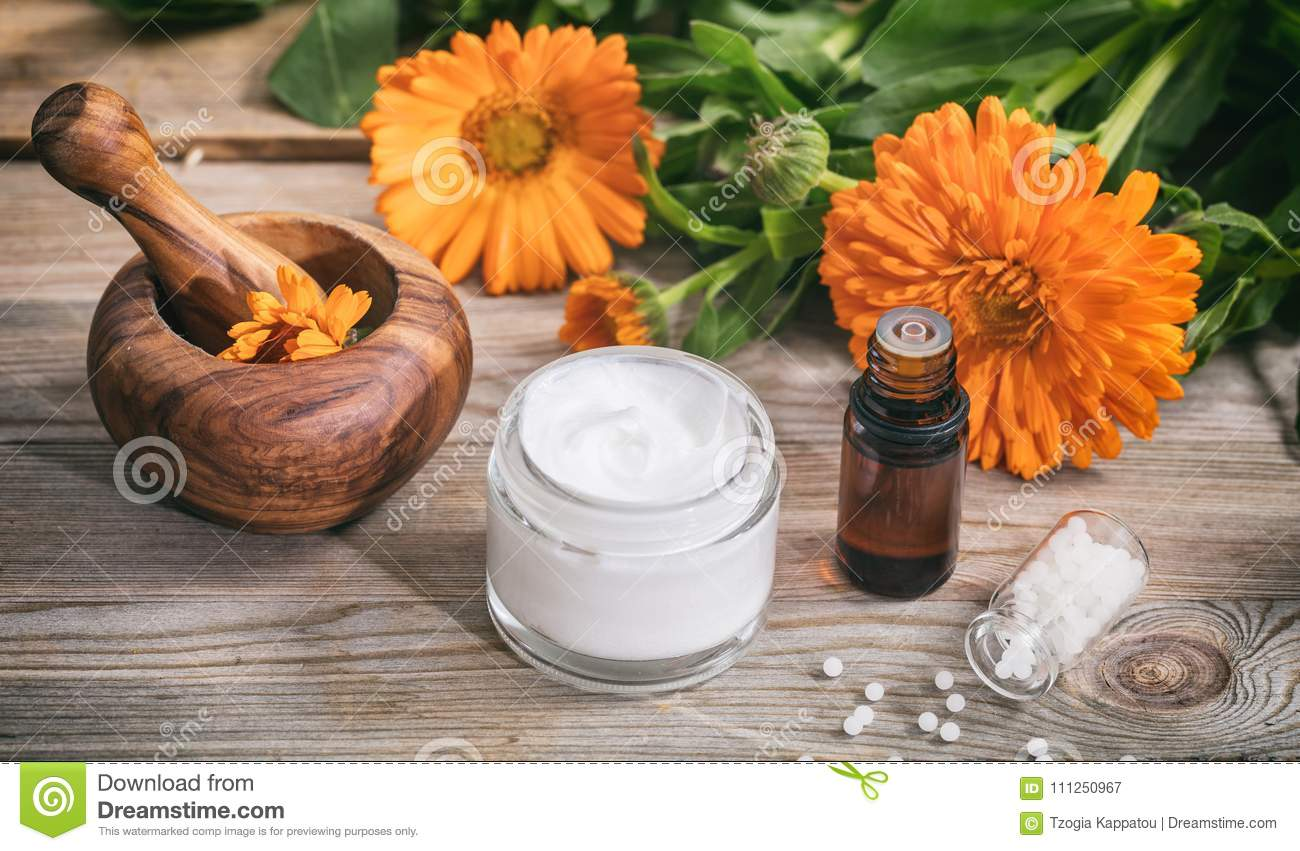Natural Medicine Essential Oil Ointment A Mortar And White Pills