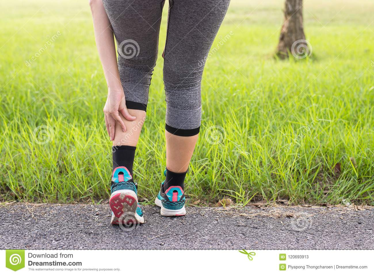 Calf muscle in pain with cramp,Woman suffering from pain in leg injury after sport exercise running jogging and workout