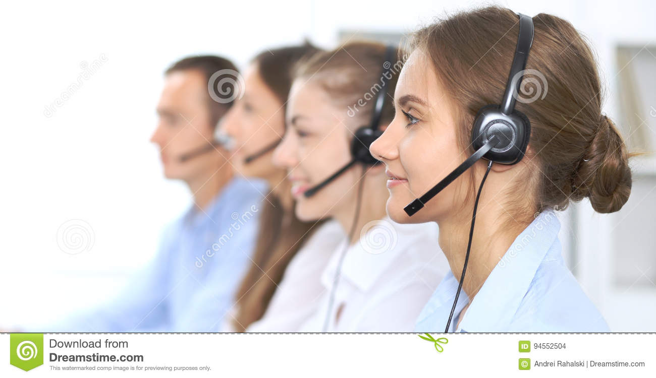 Call center operator in headset while consulting client. Telemarketing or phone sales. Customer service and business