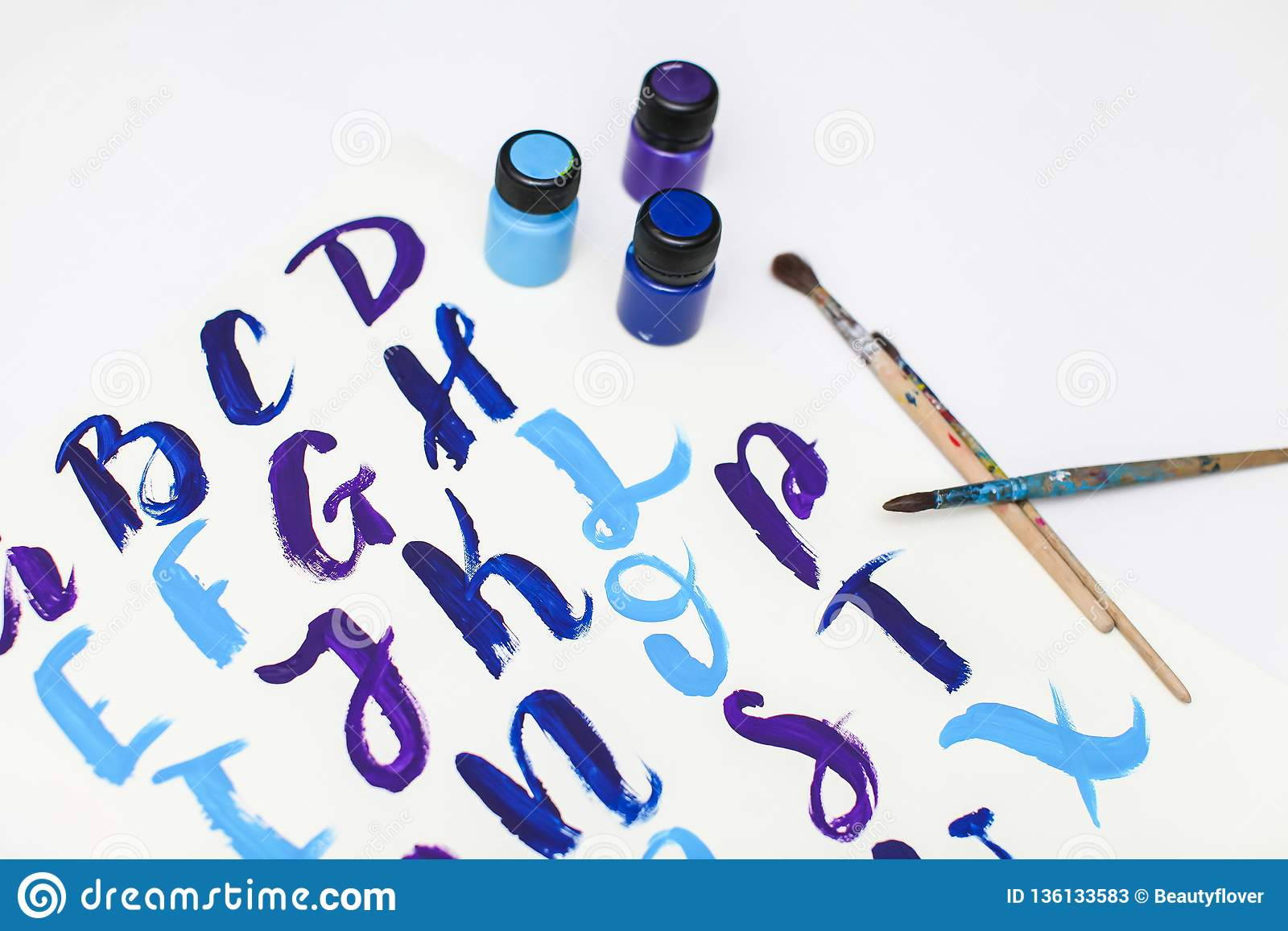 Calligraphy lettering alphabet drawn with dry brush. Letters of English ABC written with paint brush