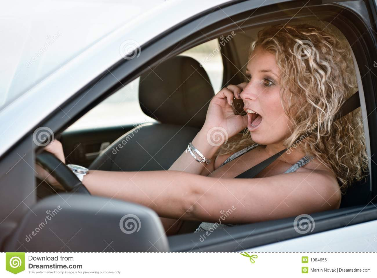 Calling Mobile Phone While Driving Car Stock Image - Image ...