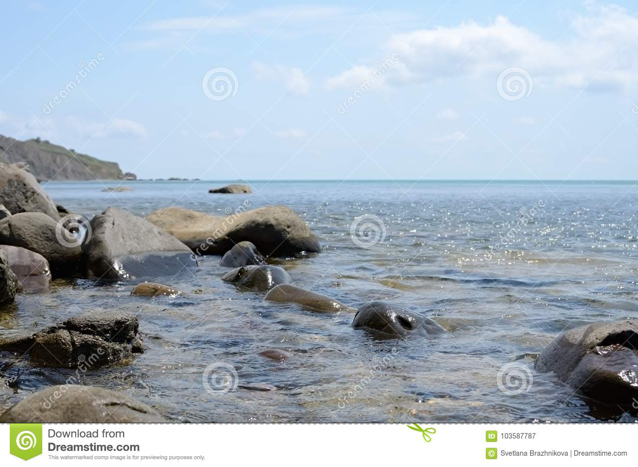 The calm Black sea with the large stones at noon