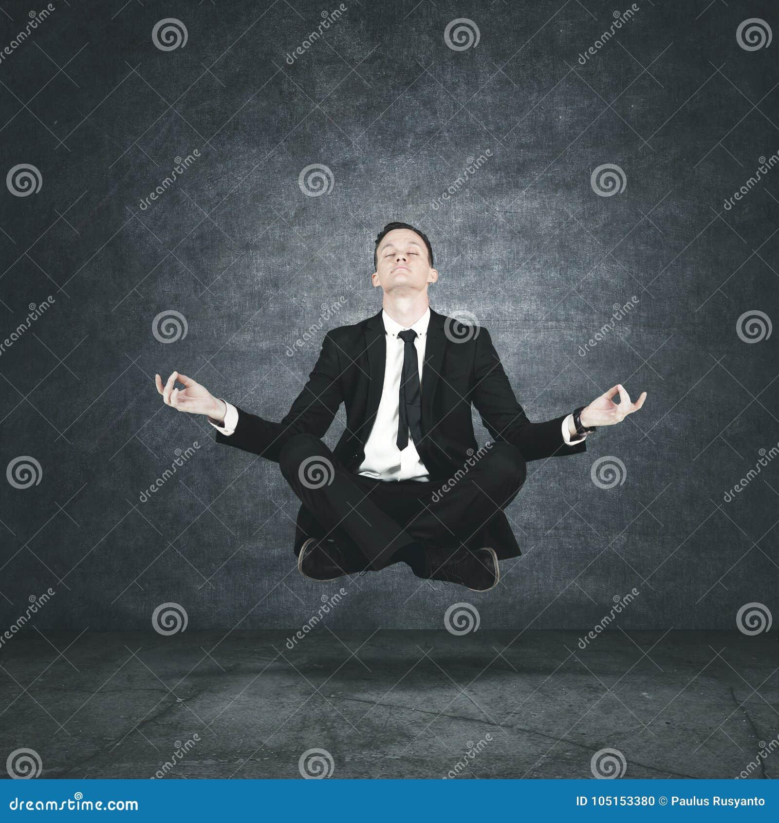 meditation businessman office. Calm Businessman Levitating During Meditation Office