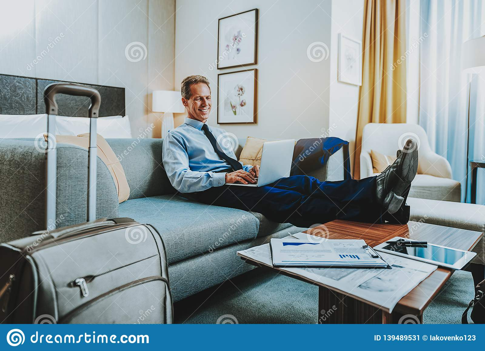 Pleasing Calm Businessman Putting Legs On Coffee Table While Sitting Theyellowbook Wood Chair Design Ideas Theyellowbookinfo