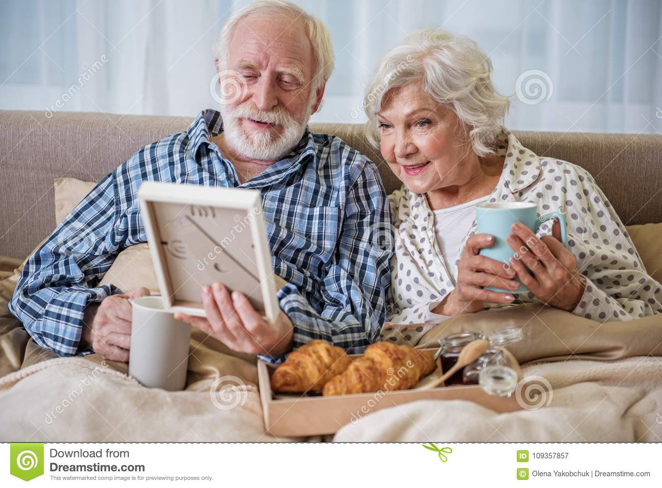 Calm Elderly Husband And Wife Having Rest At Home Stock Image