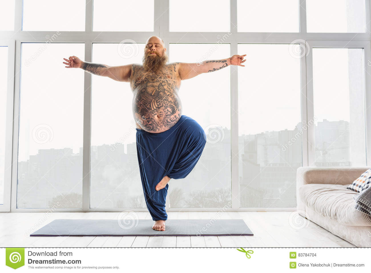 Calm Fat Man Relaxing With Meditation Relaxed Bearded Thick Guy Is Doing Yoga At Home