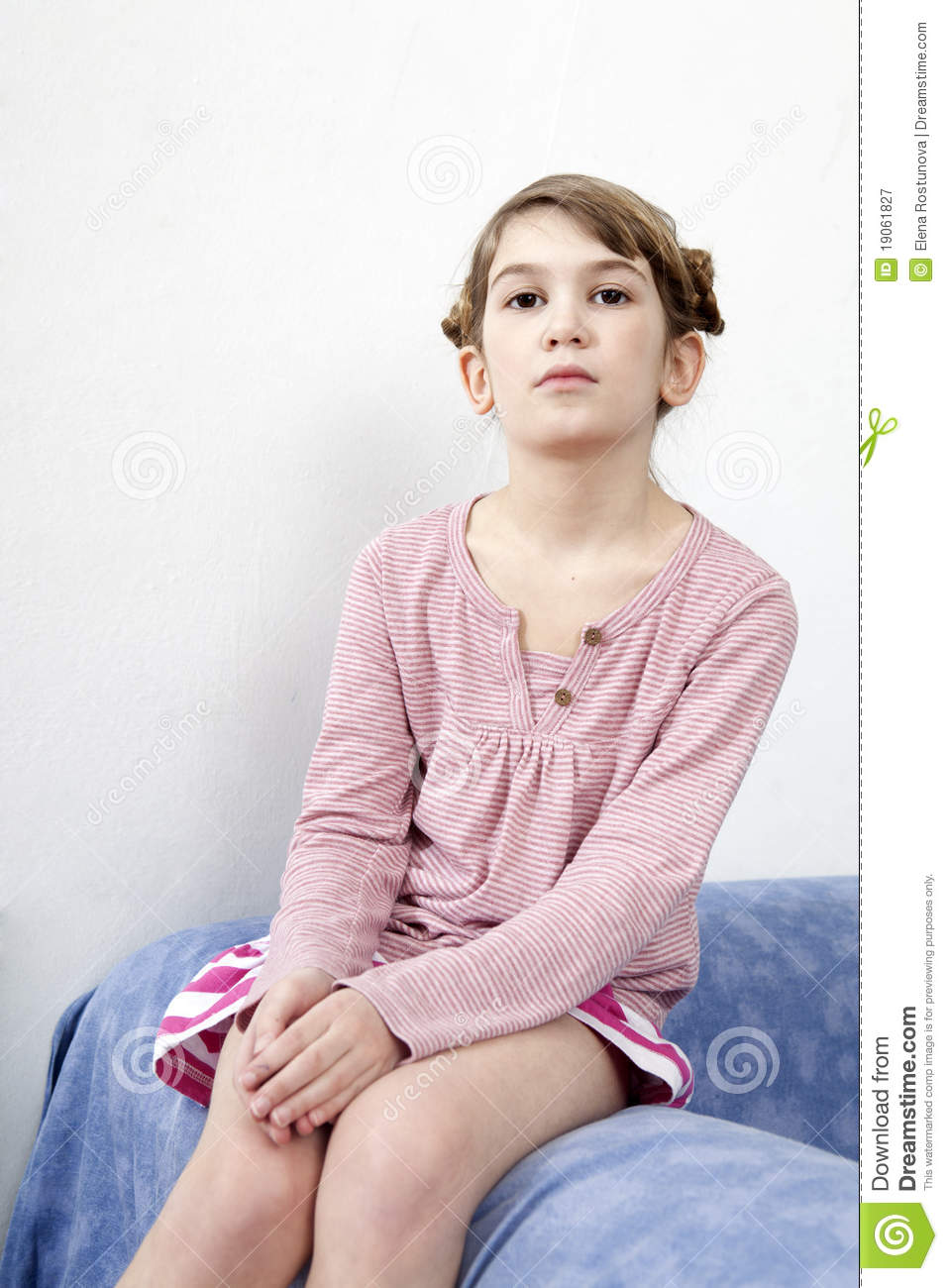 Calm Little Girl Sitting On Chair Royalty Free Stock