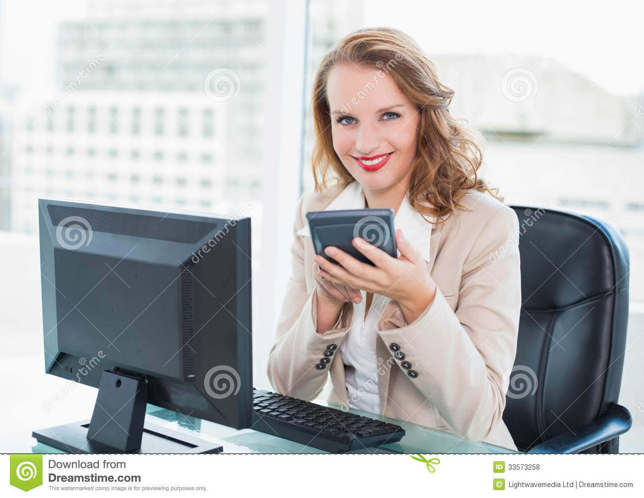 Calm Pretty Businesswoman Using A Calculator Royalty Free