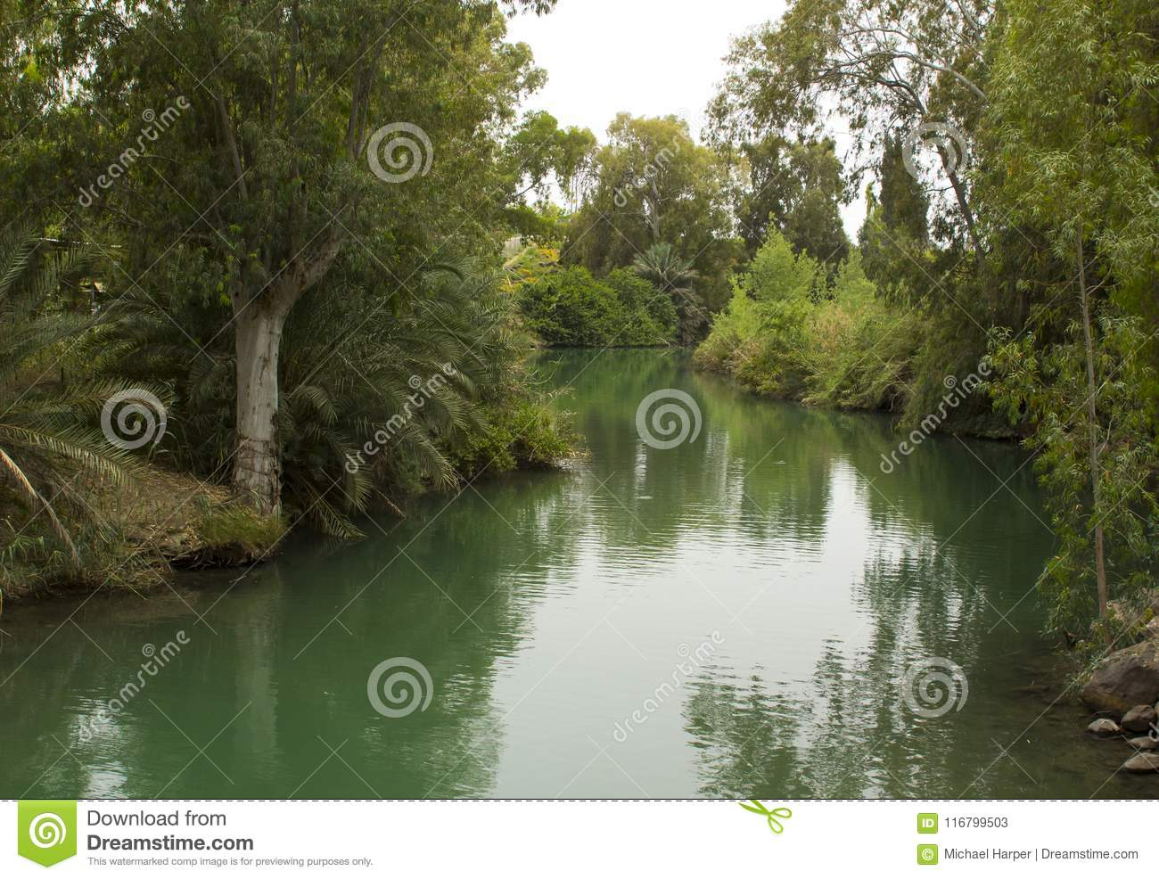 e95769636e93 The calm running River Jordan at the Yardenit Baptismal Site the  traditional place of John the Baptist and his ministry. The facility can be  used for ...