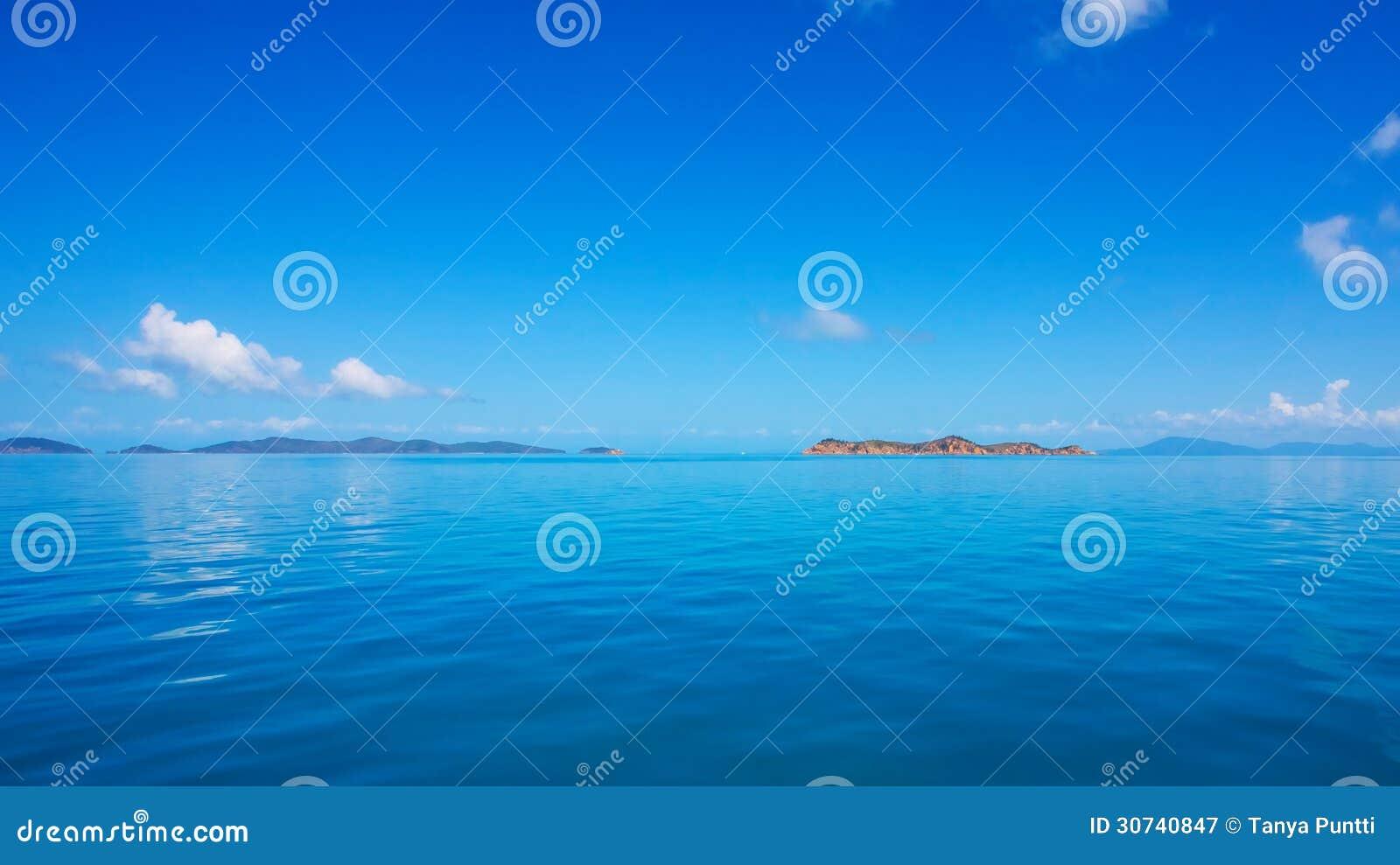 Calm sea, blue ocean sky and horizon