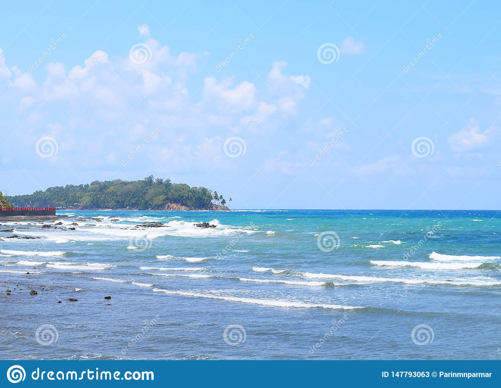 Calm Sea waves in Blue Ocean, Clear Sky and Island at Distance - Port Blair, Adnaman Nicobar Islands, India