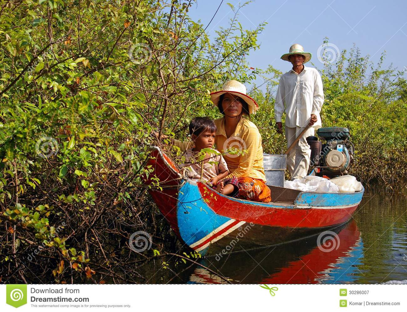 Cambodian family in fishing boat editorial photography for Best boat for fishing and family fun