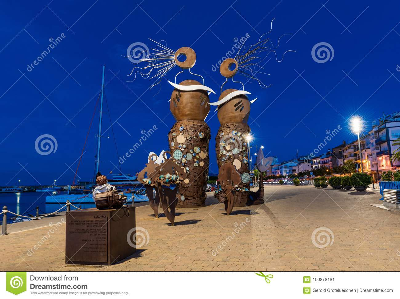 CAMBRILS, SPAIN - SEPTEMBER 16, 2017: View of the embankment of the city and the modern sculpture `The Mermaids`.
