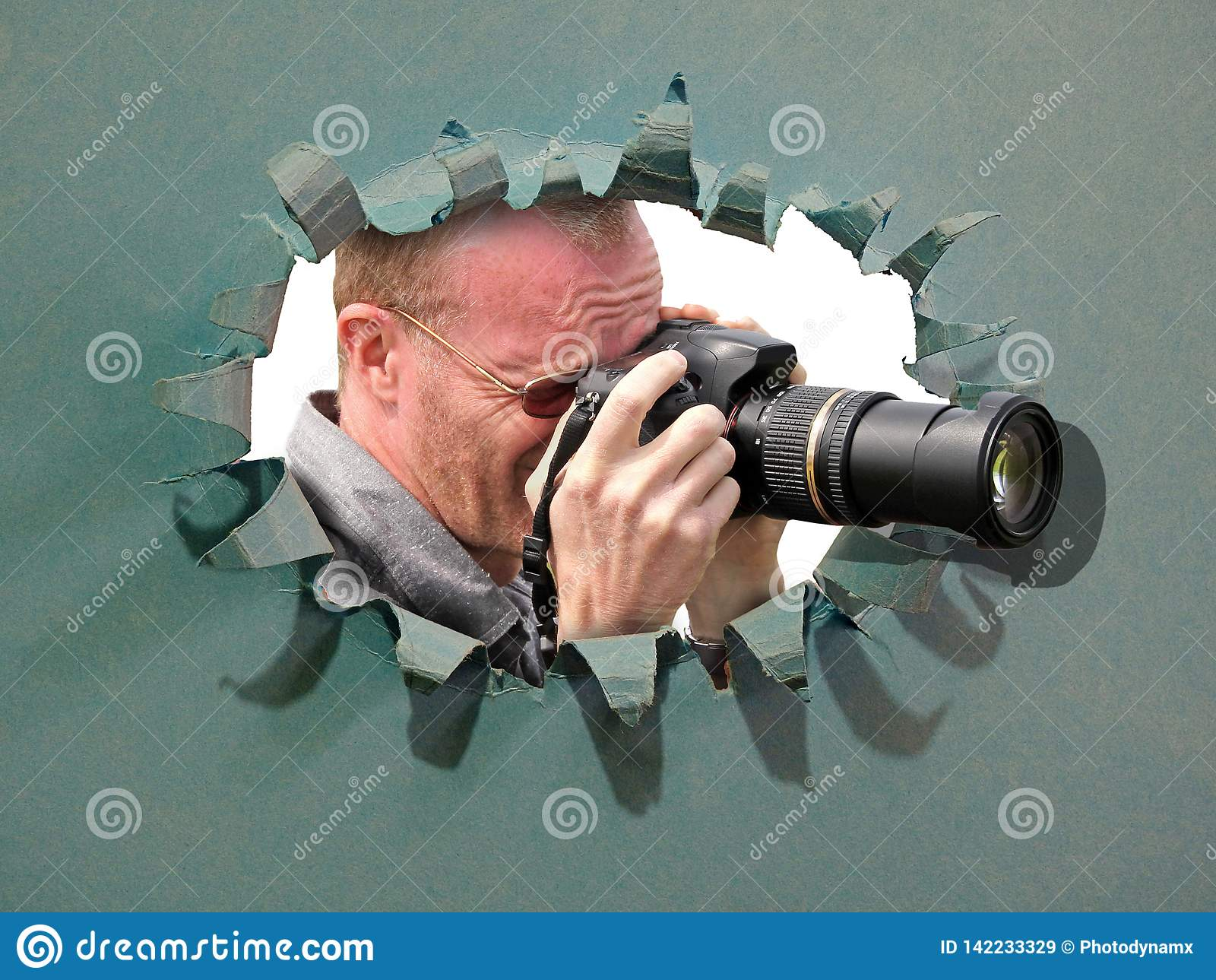 Camera cameraman using lens through hole in card breakthrough tear disguise