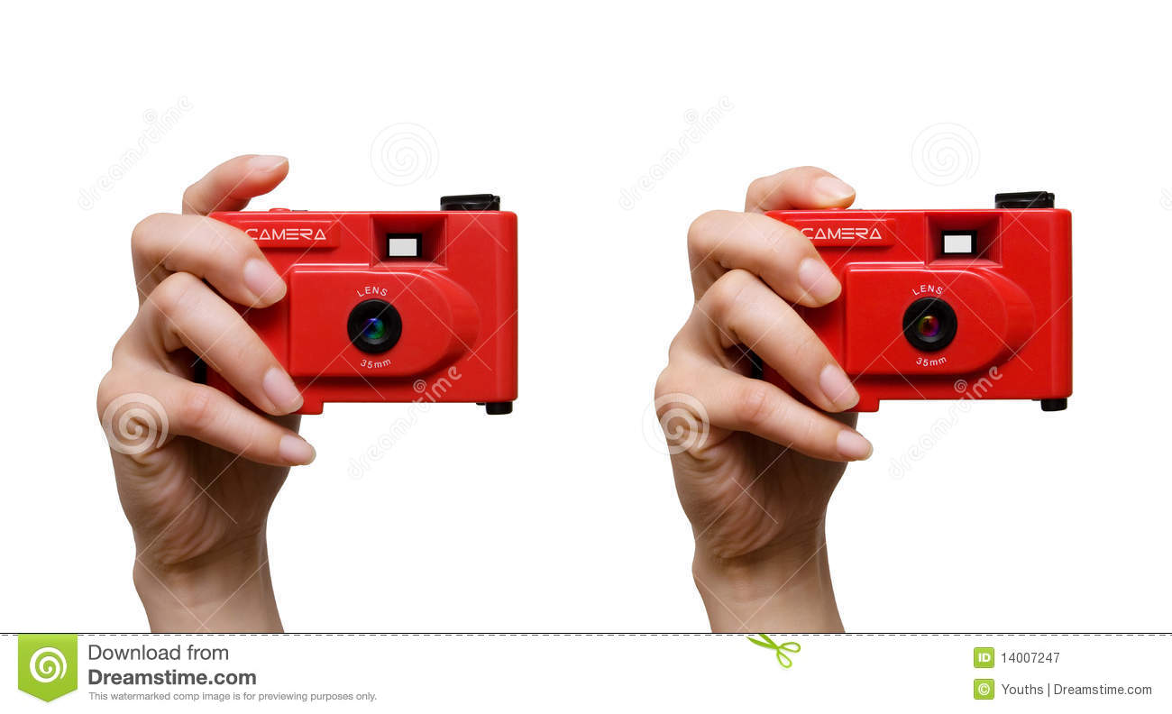 Camera in a hand isolated on white background