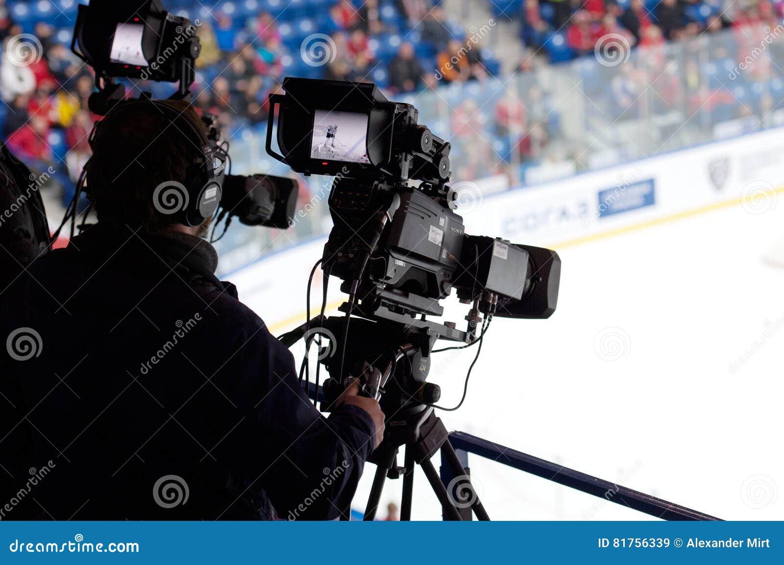 Cameraman on ice hockey game