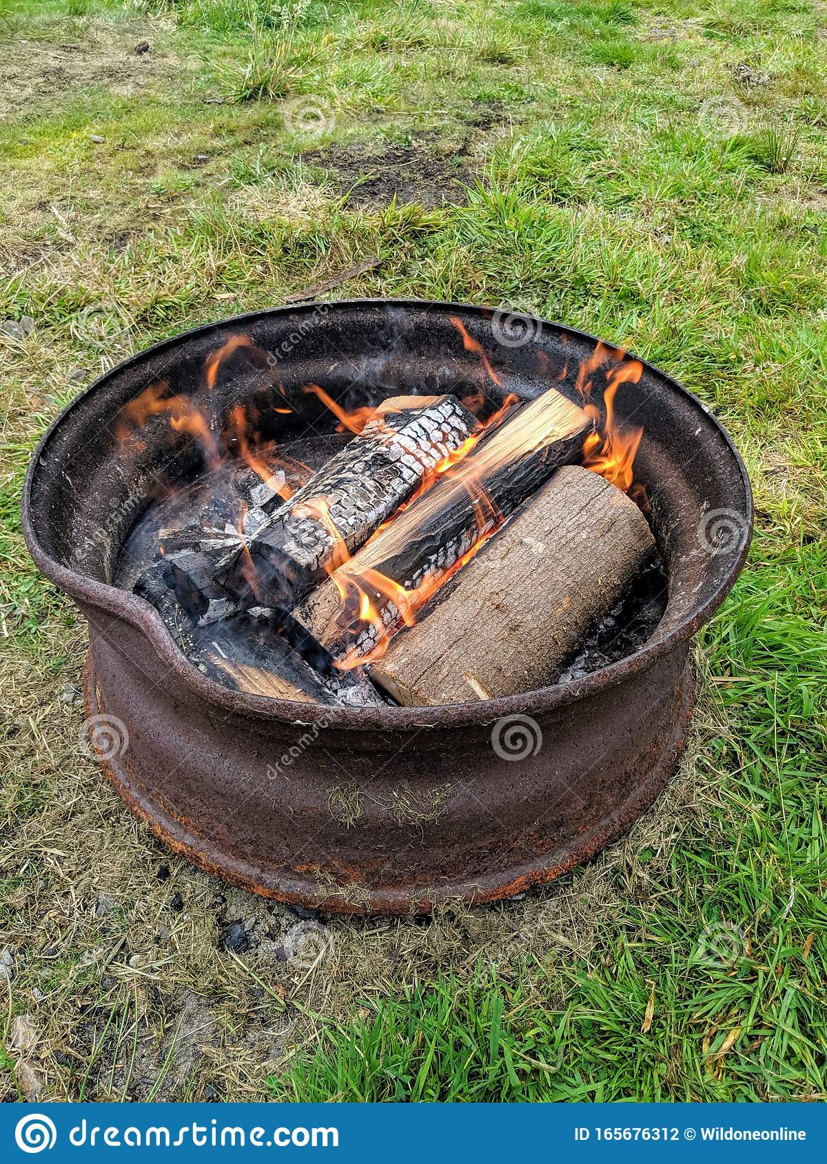 Camp Fire In A Truck Wheel Stock Photo Image Of Charcoal 165676312