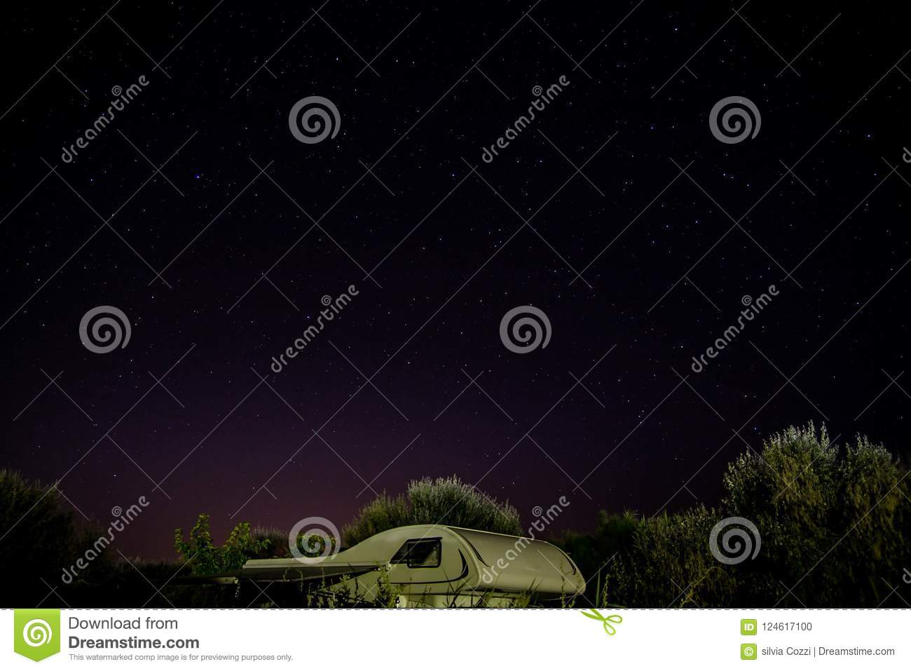 Camper Top Under A Starry Night Among Trees Background Or