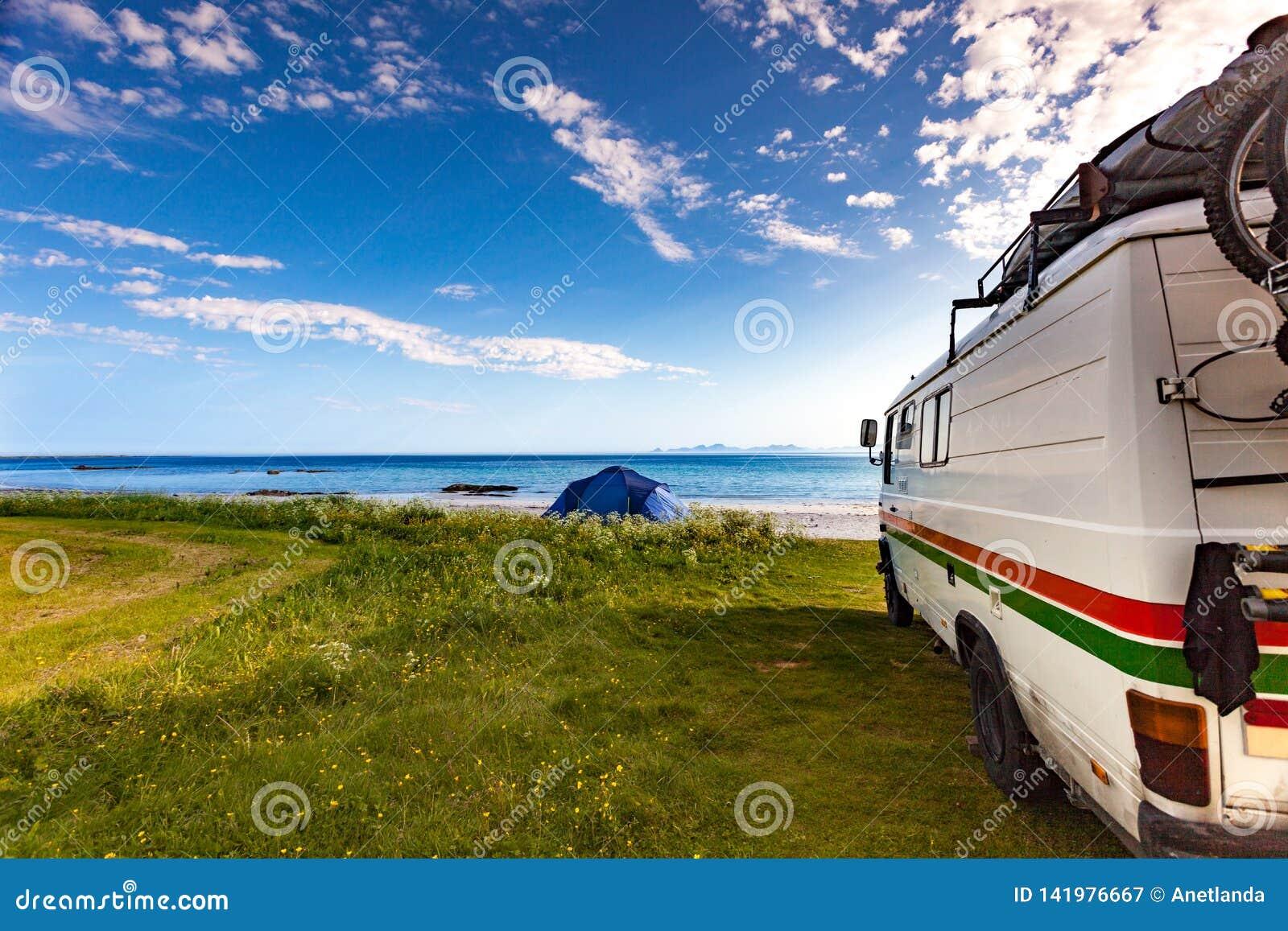 Camper van and tent on beach, Lofoten Norway