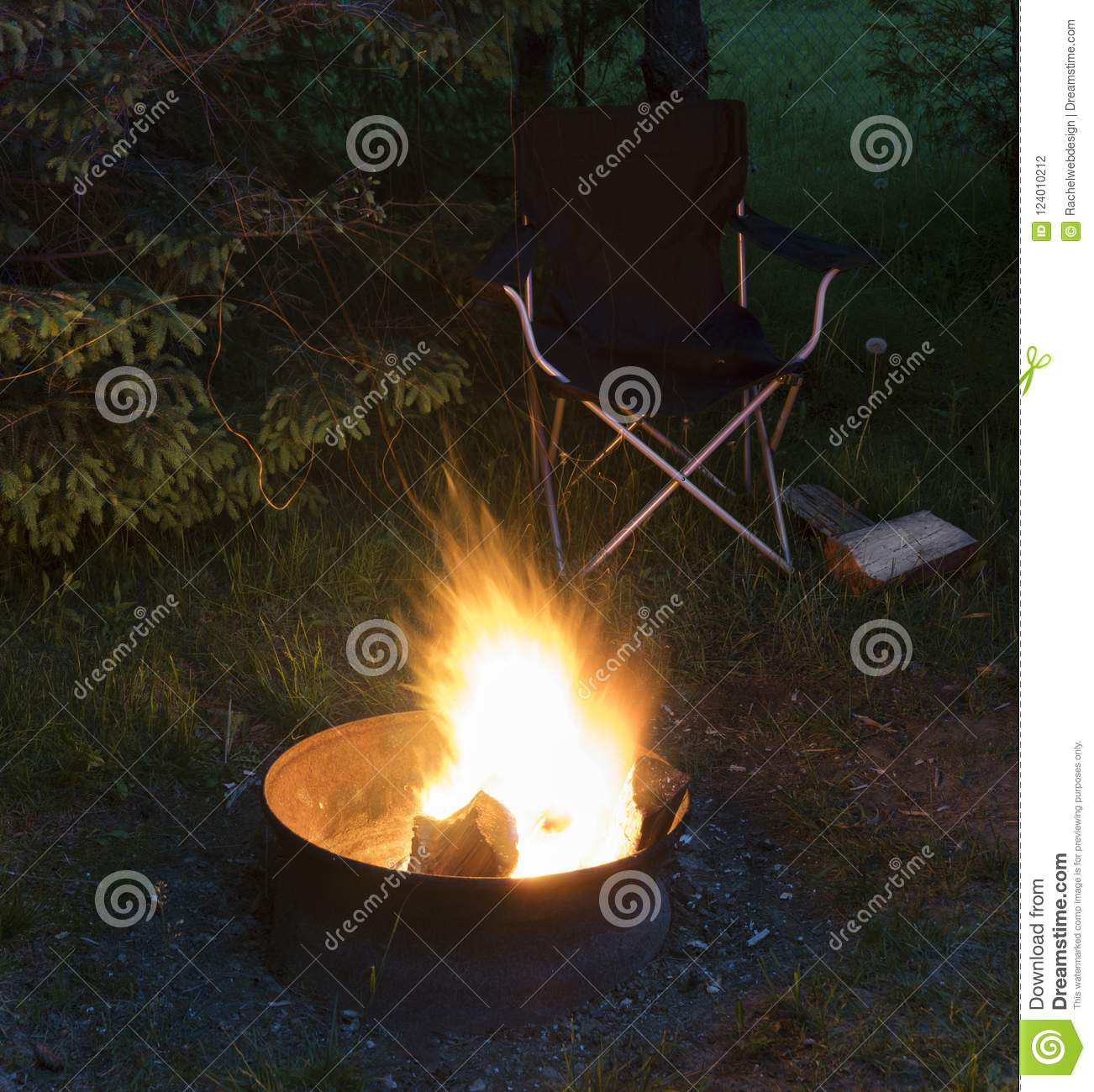 Strange Campfire Burning Brightly With Folding Chair And Stack Of Evergreenethics Interior Chair Design Evergreenethicsorg